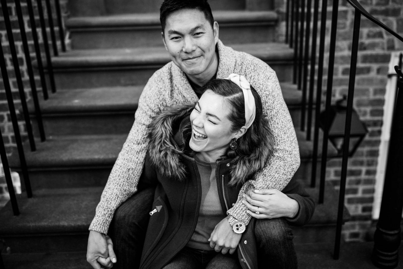 couple laughing on the stoop