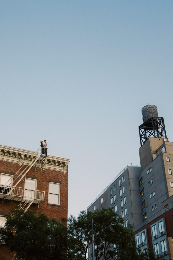 Couple standing on the roof in the Bowery